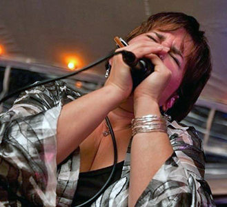 Diane Blue playing the harmonica