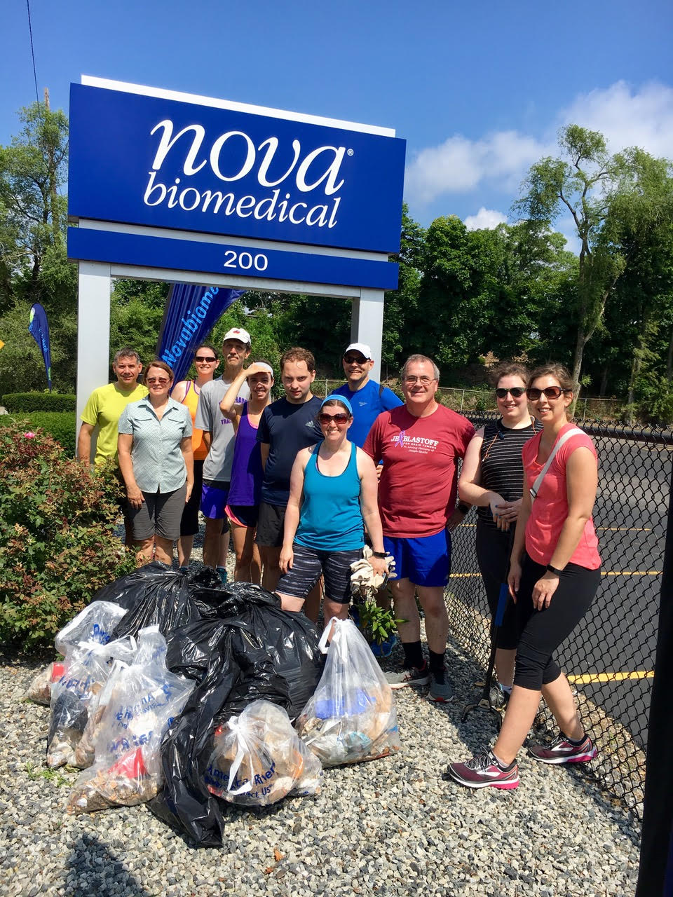 Group photo of ploggers with bags of collected trash
